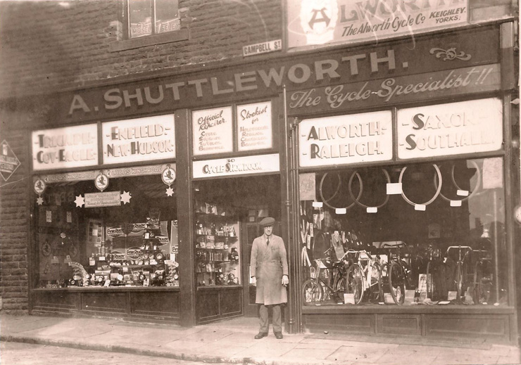 Alec Shuttleworth standing outside his shop